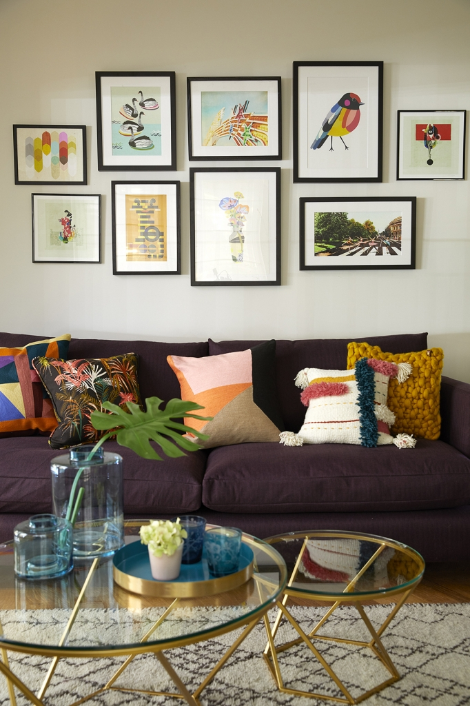 a gallery wall is a great way to add a focal point to an open plan space. Arrange centrally and nice and low over the sofa. Open plan spaces can be hard to interior design but Interior designer Sophie Robinson uses colour to unify the different areas