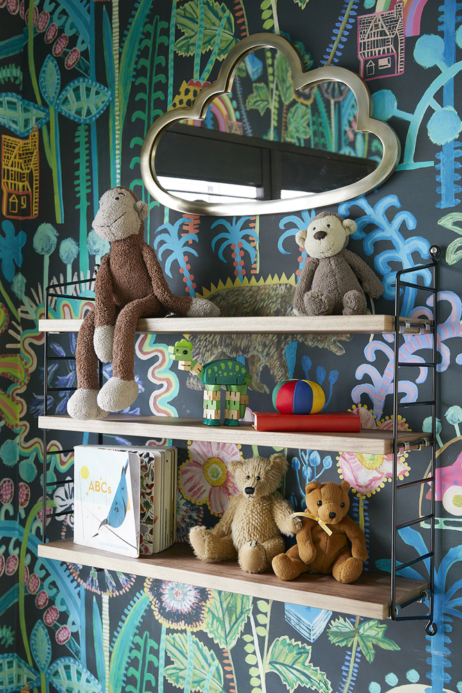lucy tiffney Mr Bear wallpaper with jungle print motif with string shelves for display in the perfect nursery
