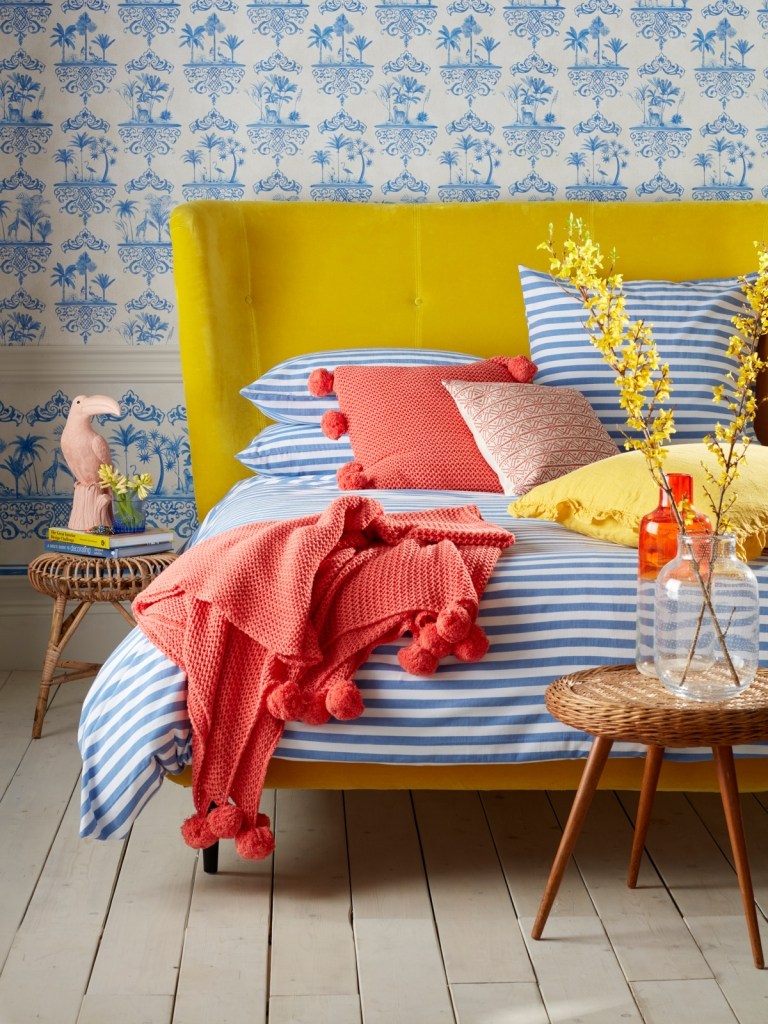 Breton stripe blue and white linen with canary yellow velvet headboard. Part of the new bedlinen range by Sophie Robinson for the secret linen store
