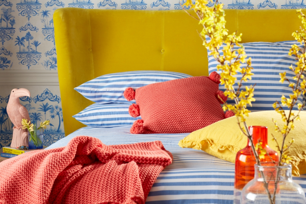 coral pom pom cushion and throw, part of the range designed by Sophie Robinson for The secret Linen store