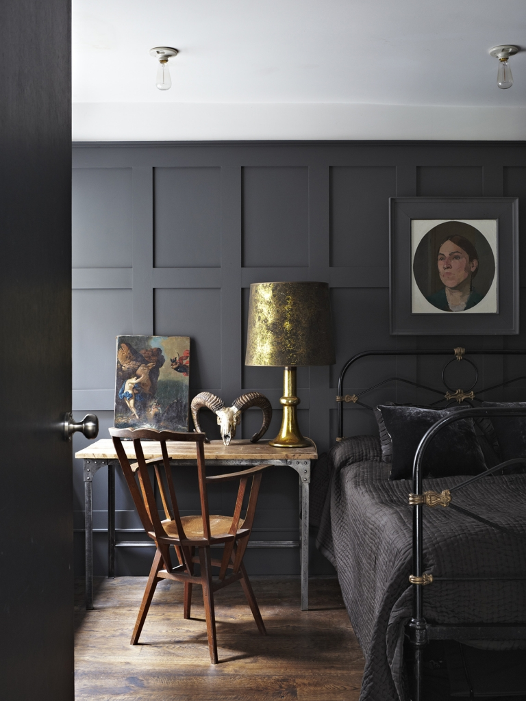 Dramatic bedroom with panelled walls in Railings by Farrow & Ball