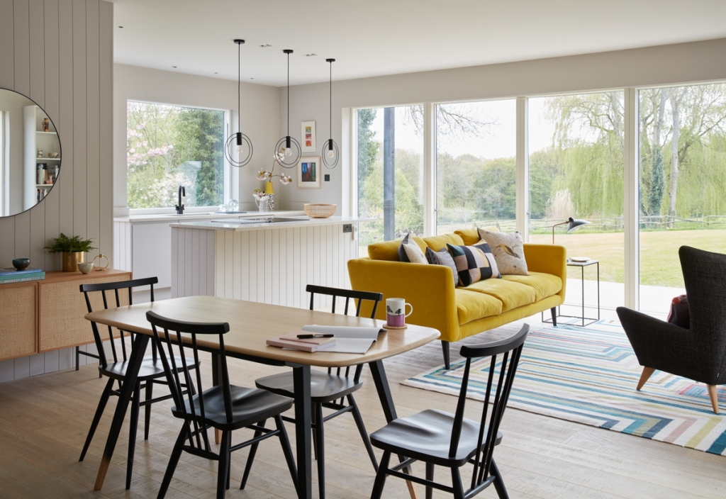 open plan living dining kitchen with large picture windows from velfac