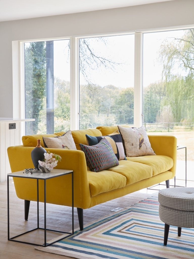 Bright canary yellow velevet sofa from sofa.com as seen in the granny annex at the home of interior designer sophie robinson