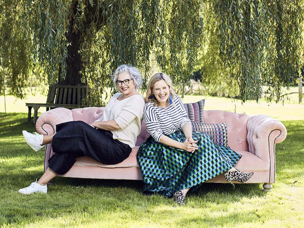Interior designer Sophie Robinson and journalist Kate Watson-Smyth The Great Indoors podcast, pink velvet sofa in garden