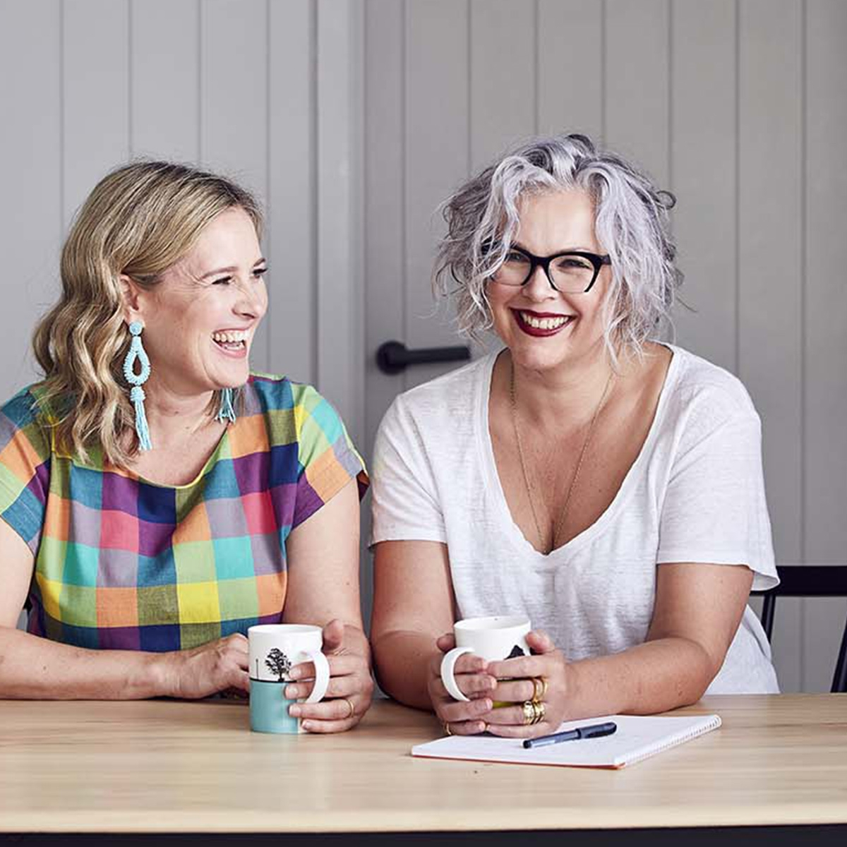 Interior designer Sophie Robinson and journalist Kate Watson-Smyth The Great Indoors podcast grey panelled wall Ercol dining table