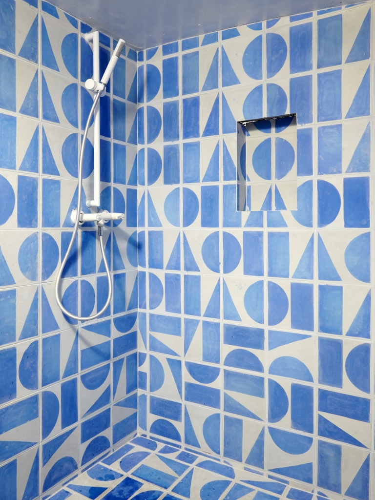 Interior Designer Sophie Robinson chooses favourite encaustic cement tiles Bert & May bright blue geometric shower room tiles