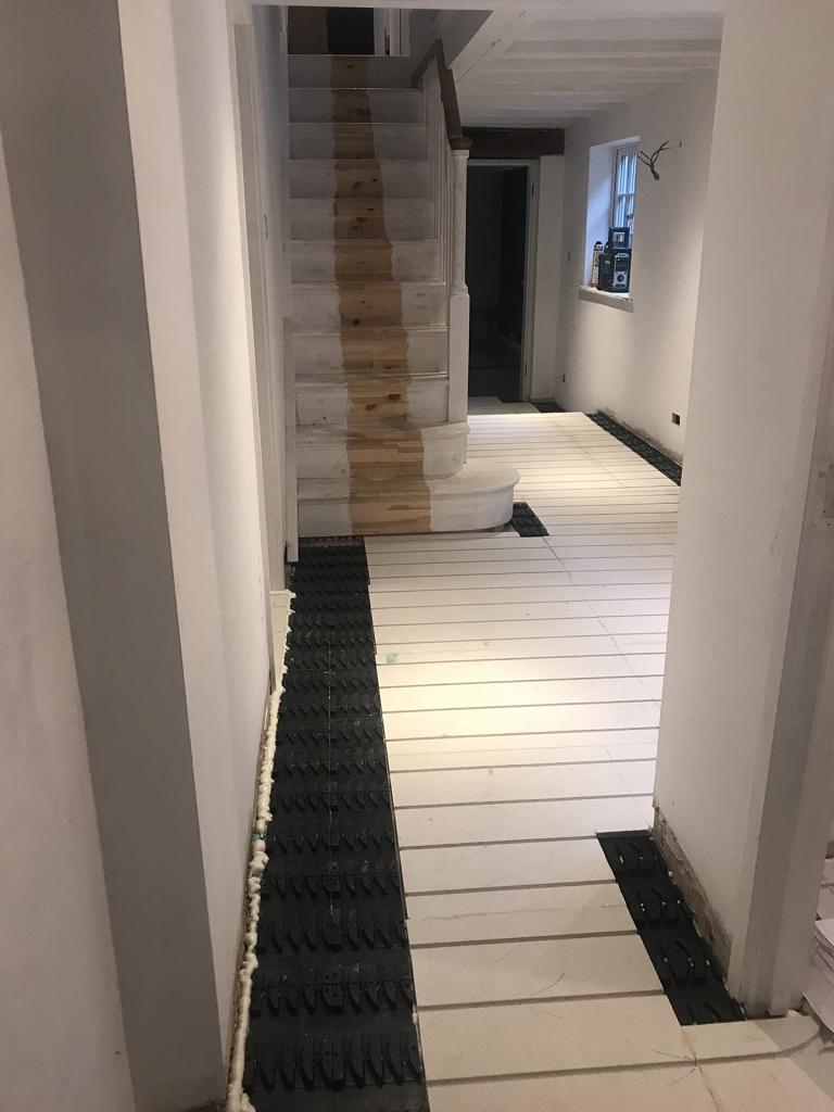 Interior Designer Sophie Robinson Victorian Sussex farmhouse renovation underfloor heating hallway
