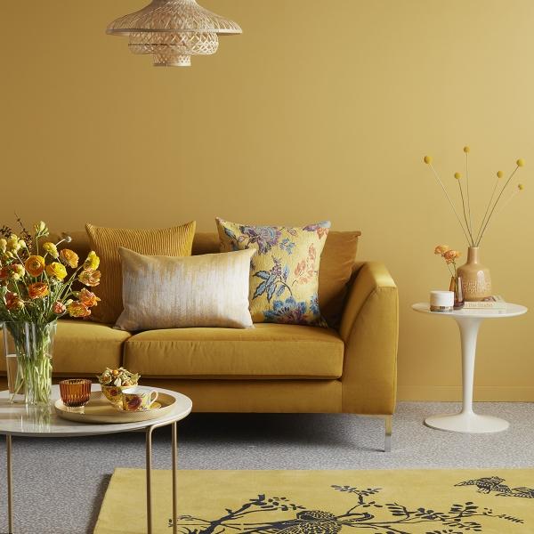 Interior Designer Sophie Robinson selects favourite velvet sofas John Lewis Belgrave mustard and mustard wall patterned rug