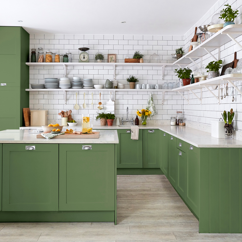 Shaker style kitchen with metro tiles for amodern country look. green painted kitchen units in sanderson paints devon green
