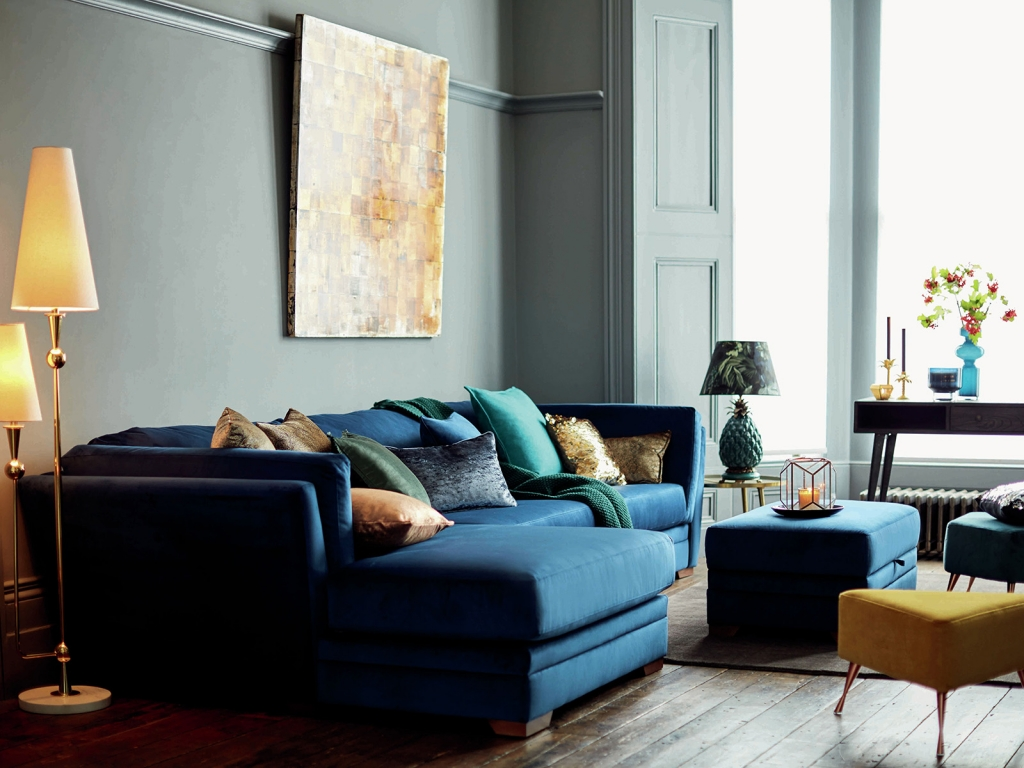 Interior Designer Sophie Robinson talks about Why Staying in is the new going out, cosy Blue velvet corner sofa