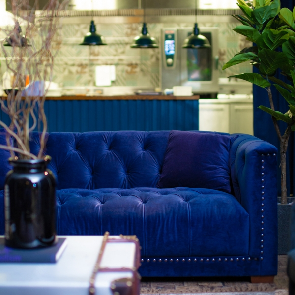 Interior Designer Sophie Robinson talks about Why Staying in is the new going out, DFS blue velvet sofa in bar area