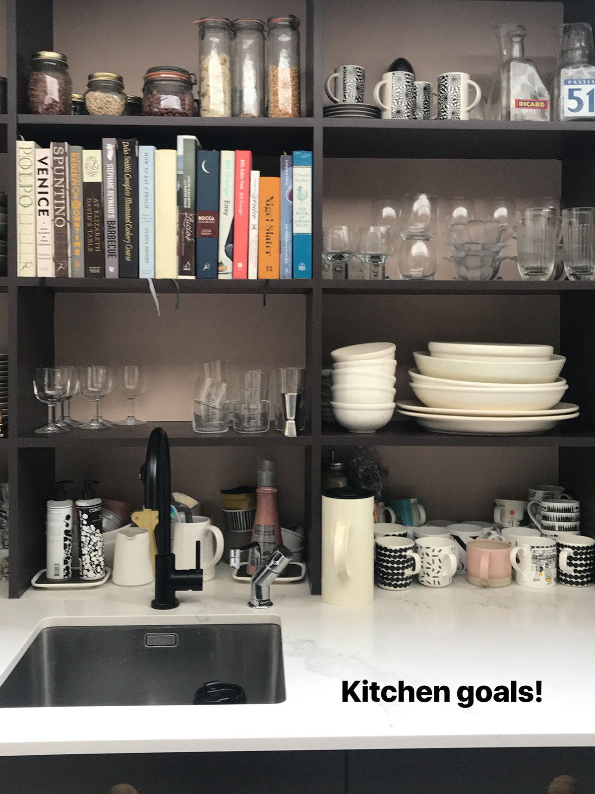 Interior Designers Sophie Robinson talks kitchen update with organised kitchen shelves above the sink