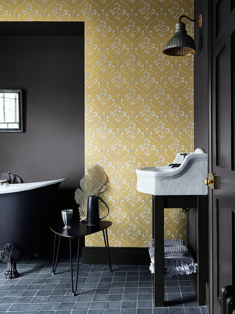 Interior designer Sophie Robinson talks about interiors mustard trend, Cranford wallpaper in Wheat by Little Greene shown in bathroom with black accents