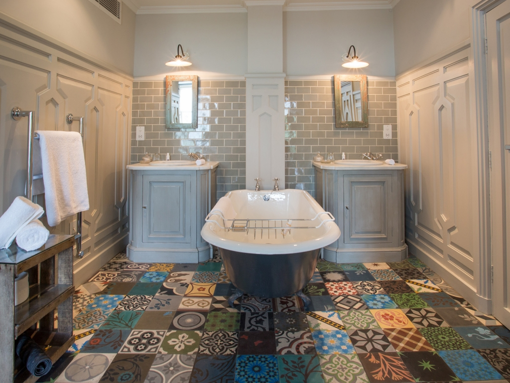 Interior Designer Sophie Robinson talks about Why Staying in is the new going out, The Pig Hotel patchwork tiled bathroom floor