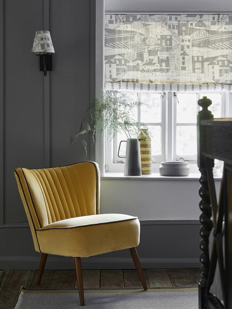 Interior designer Sophie Robinson talks about mustard trend, velevet chair by Vanessa Arbuthnott grey walls