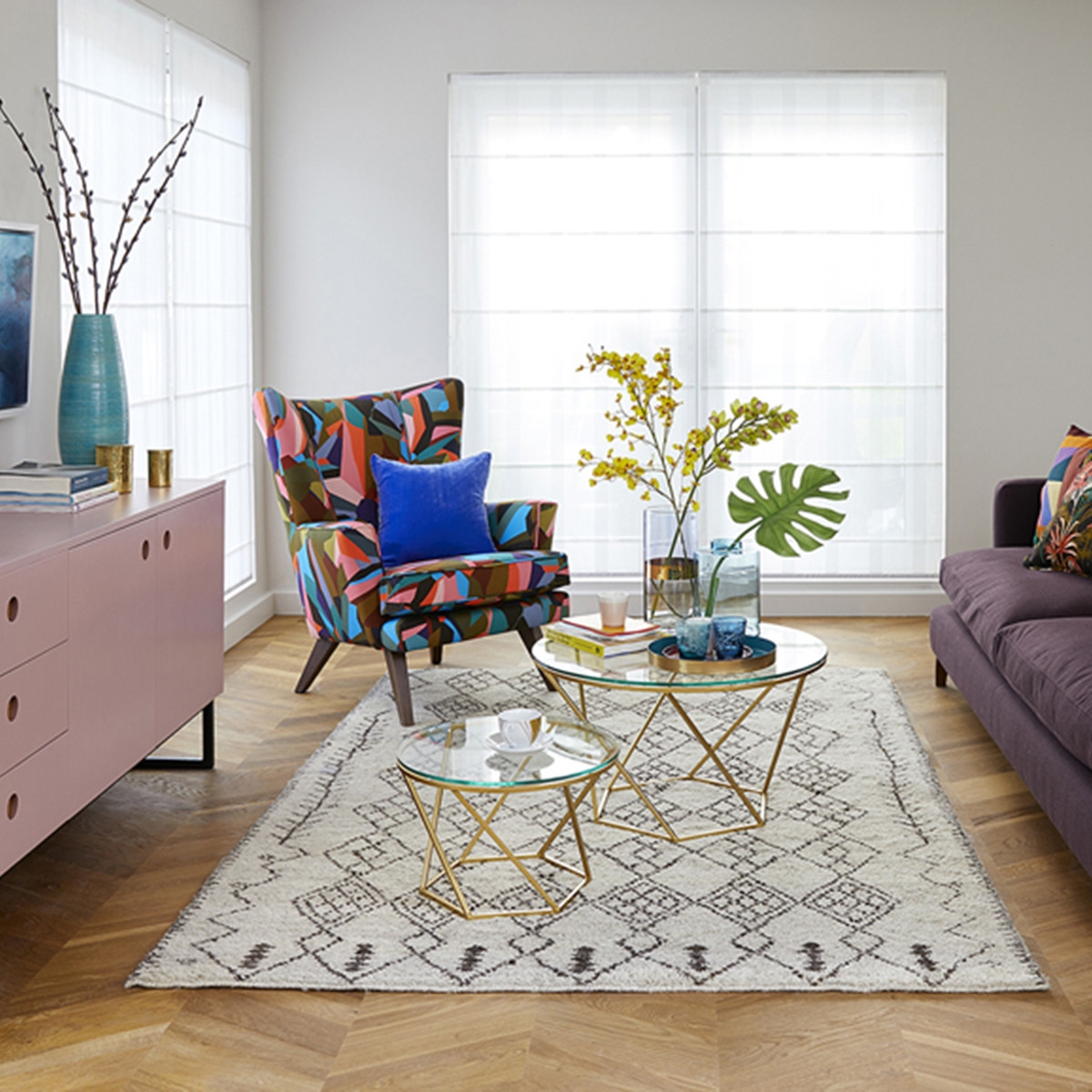 Interior designer Sophie Robinson design living room for Ideal Home Show gallery wall and pale pink sideboard and Quick-Step Intenso herringbone floor