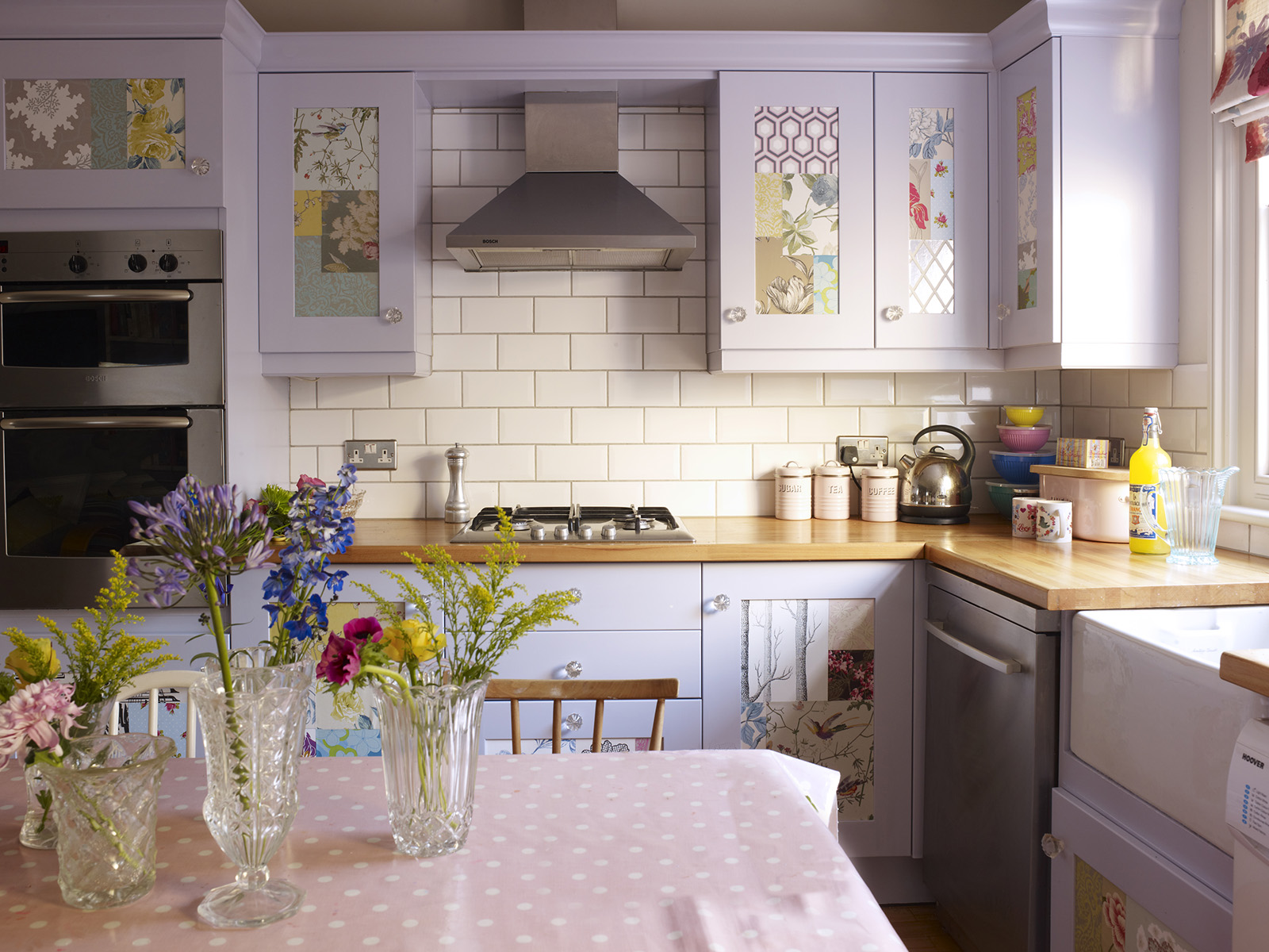 Interior Designers Sophie Robinson talks kitchen update Pastel kitchen units and patchwork panelled doors