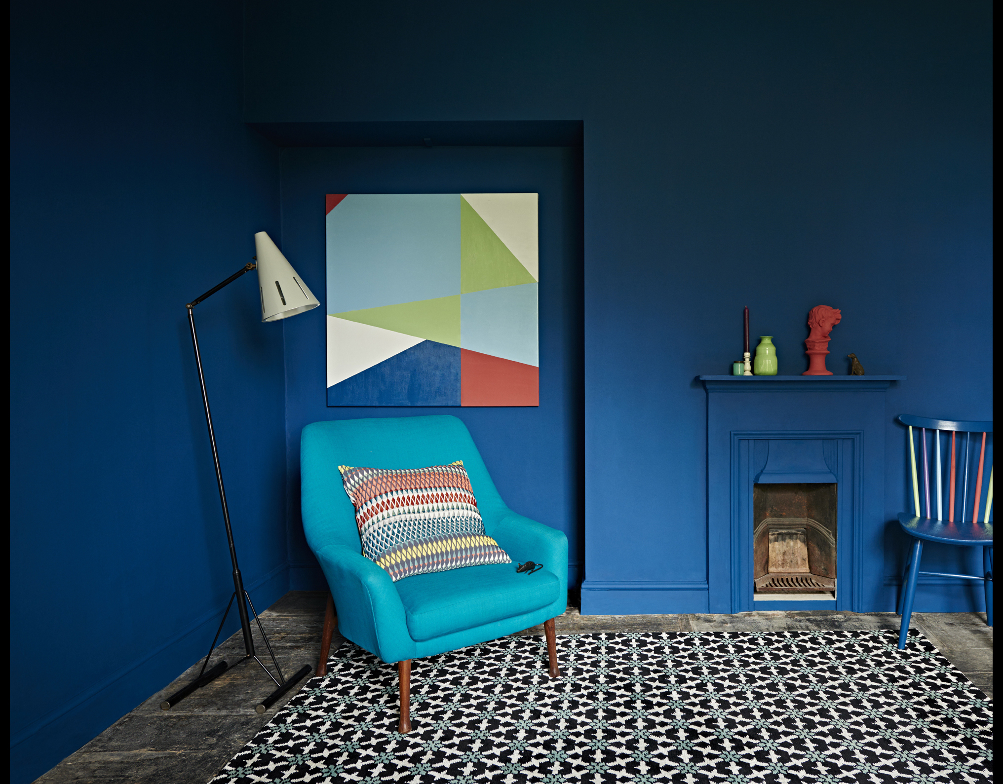 Sophie Robinson and Kate Watson Smyth discuss if designer paint is worth the money. this blue living room with geometric floor and deep blue walls is by Eco paint brand Earth born