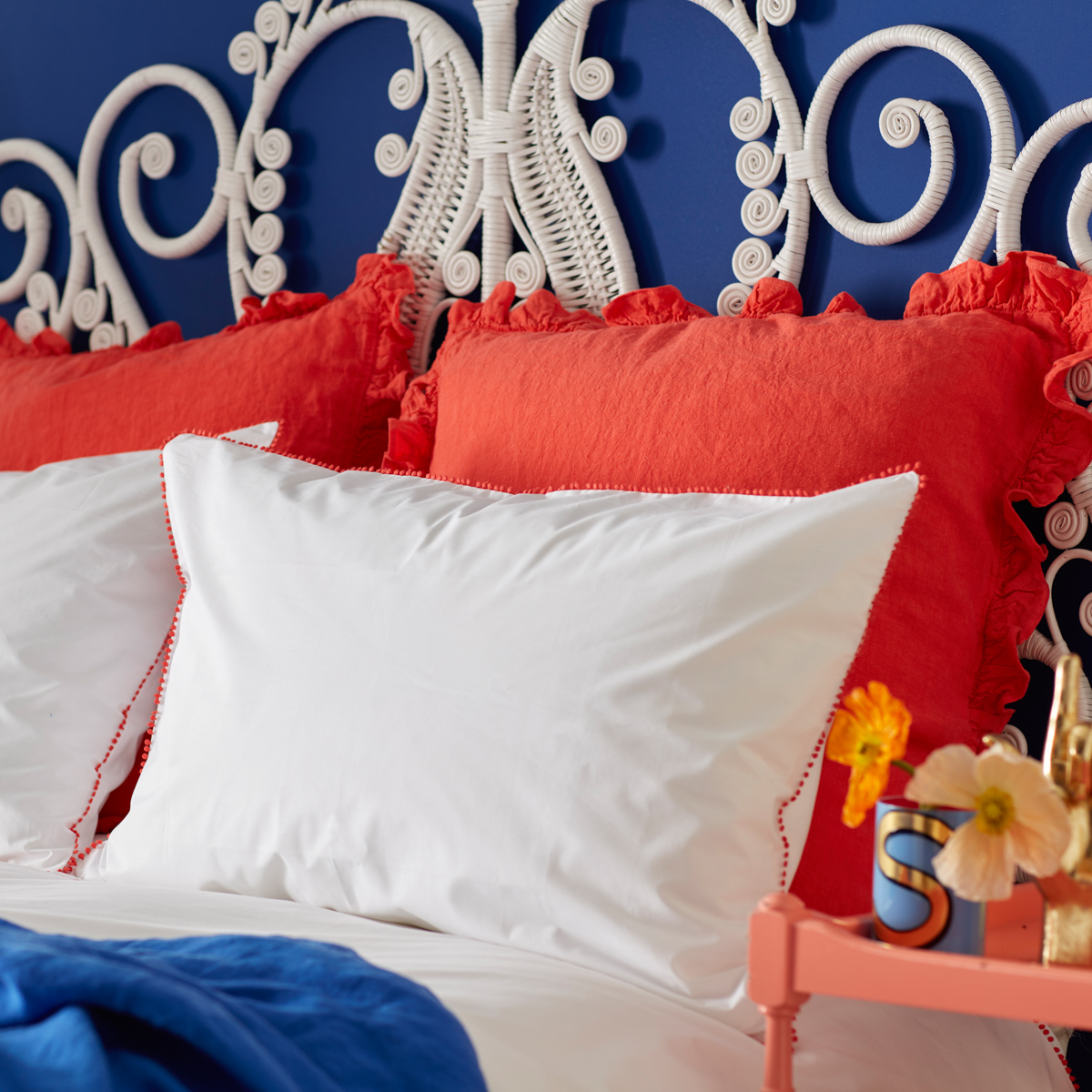 pantone colour of the year living coral features in this pom pom fringed bedlinen designed by sophie robinson for the secret linen store