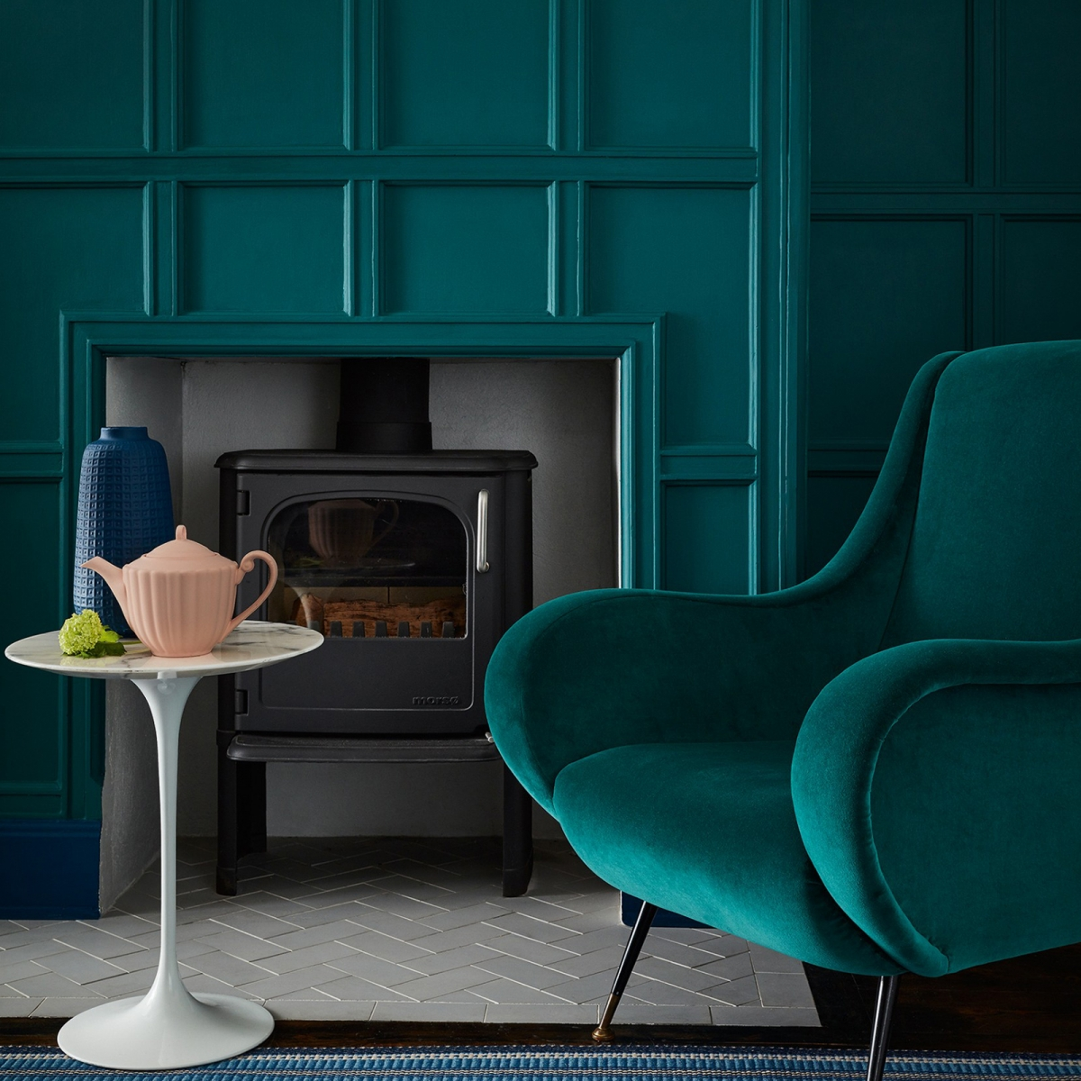 interior designer sophie robinson shows you how to decorate with teal, painted panelled wall and velvet armchair