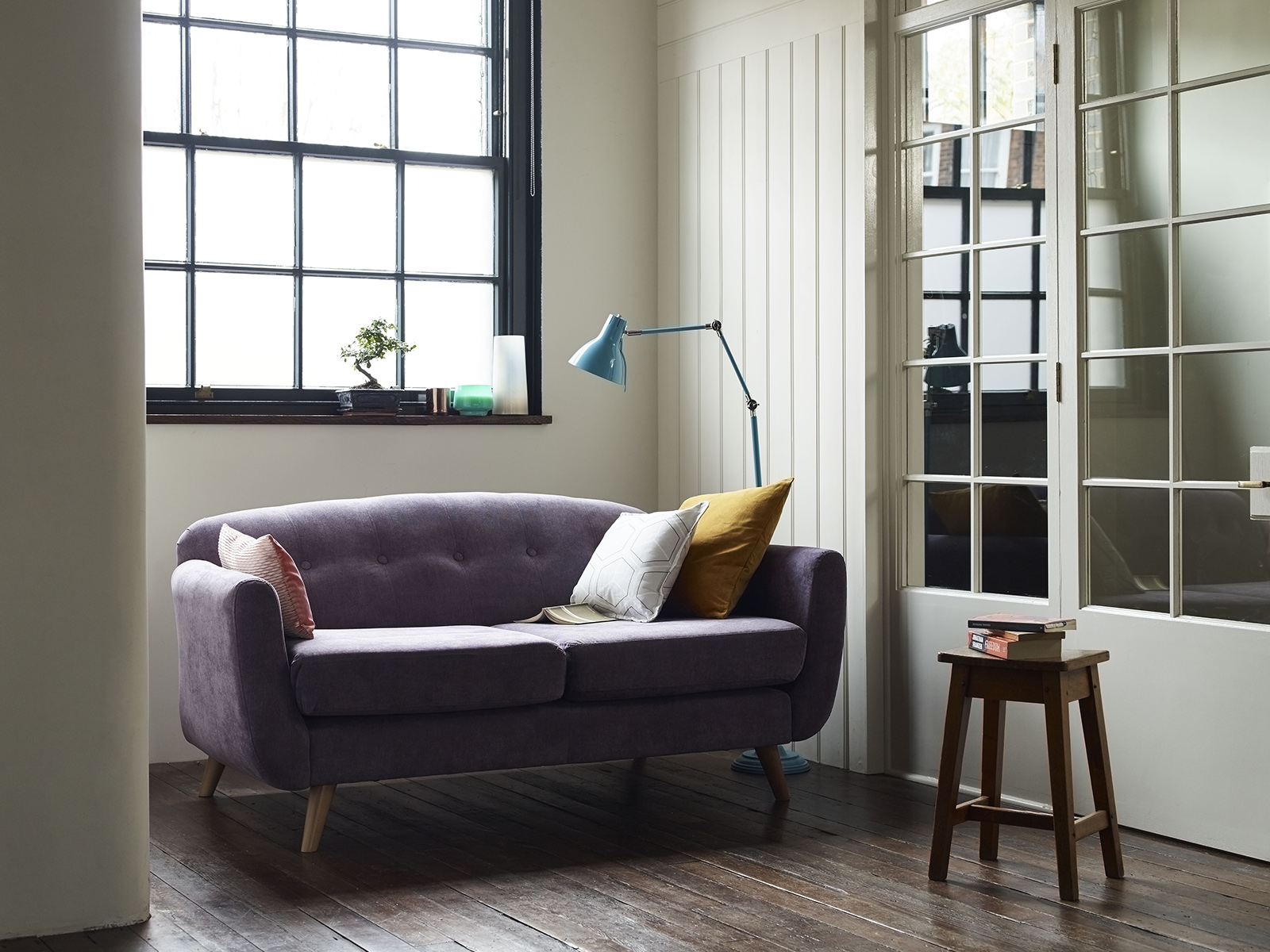 When designing small psaces choose furniture that is compact in design with slender arms and raised on legs. The capsule range from DFS is especially deisgned for small rooms. For more ideas on small space living listen to The Great Indoors Podcast by Sophie Robinson and Kate watson Smyth here