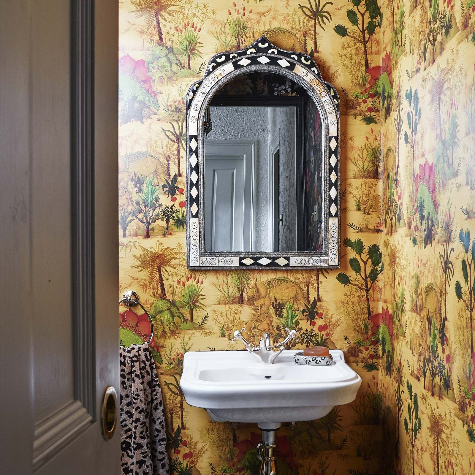 Interior designer and colour queen talk about the recent trend she's calling jungle chintz. Celebrating a long lost kingdom the Dinosaura wallpaper by House of Hackney will take centre stage in any room such as a bathroom as shown here.