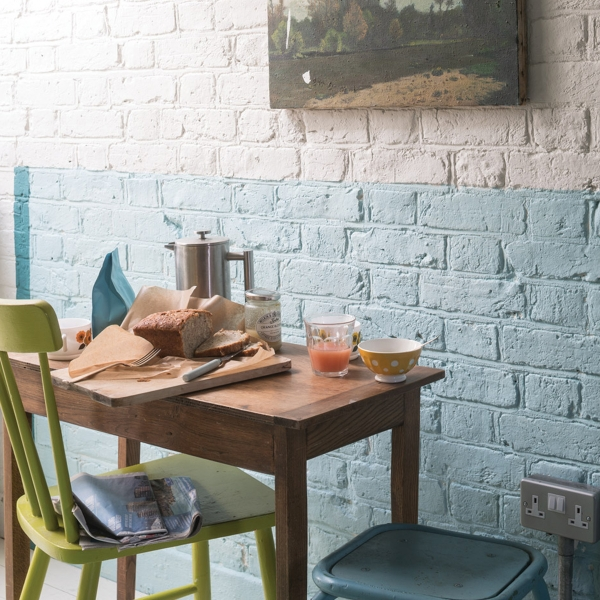 Interior Designer Sophie Robinson advises on how to make small spaces appear bigger. make a room feel more spacious is by using just two colours and creating a painted dado rail. Choosing a lighter shade on the top will create a sense of height as it will appear to flow into the ceiling. #sophierobinson #twotonewalls #decorating #farrowandball