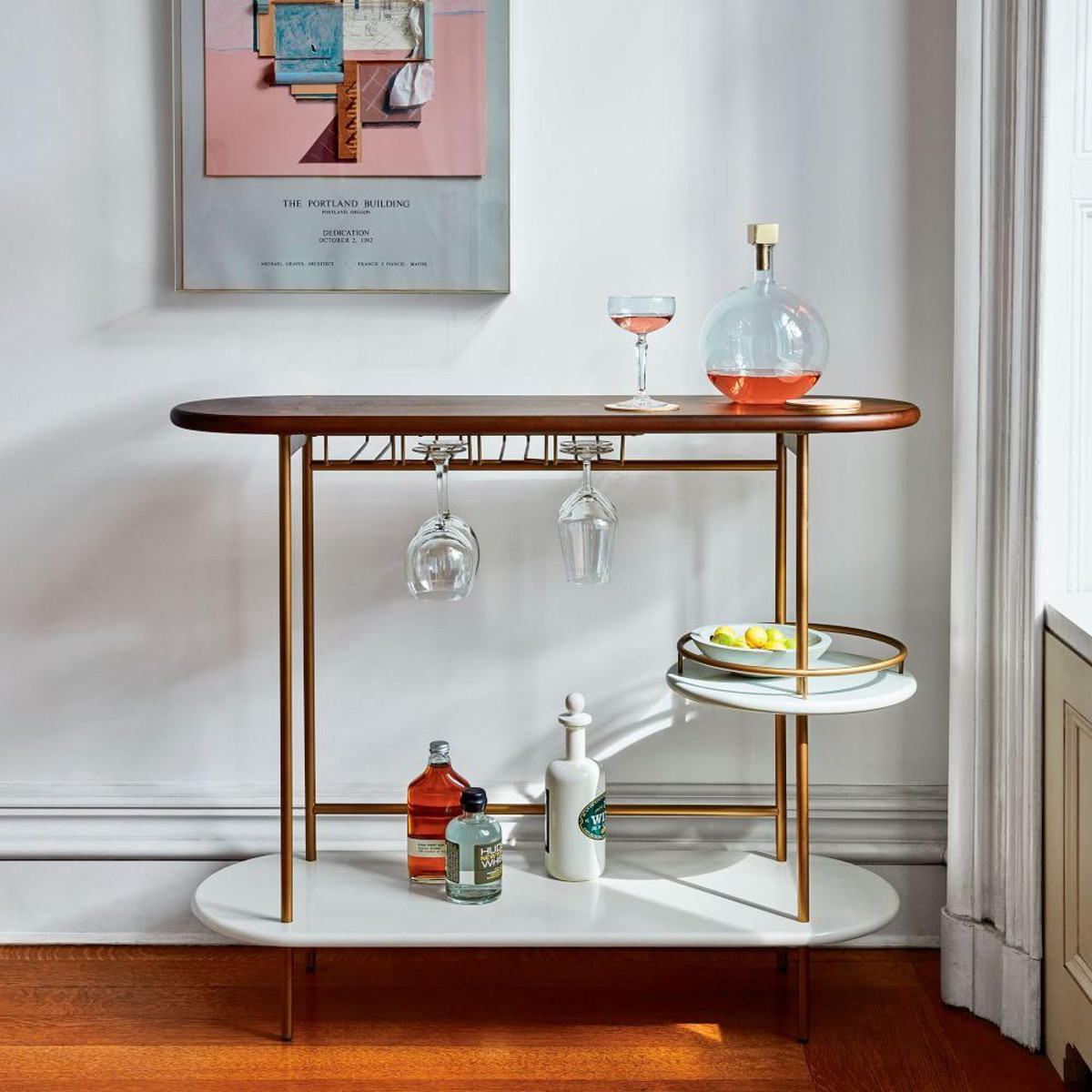 Sophie Robinson discusses one her favourite interior trends -curves and lozenge shapes. This classic yet 'on trend' drinks stand by West Elm is the perfect addition to any dining room or living room. #sophierobinosn #drinkstrolley #westelm #interiors