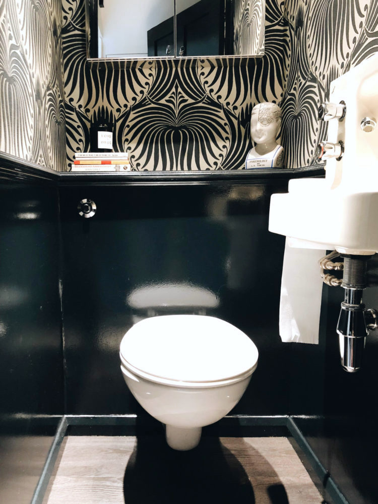 The down stairs loo is an opportunity to make a big imapact with black and whote monochrome scheme as seen in the home of interiors author Kate watson Smyth