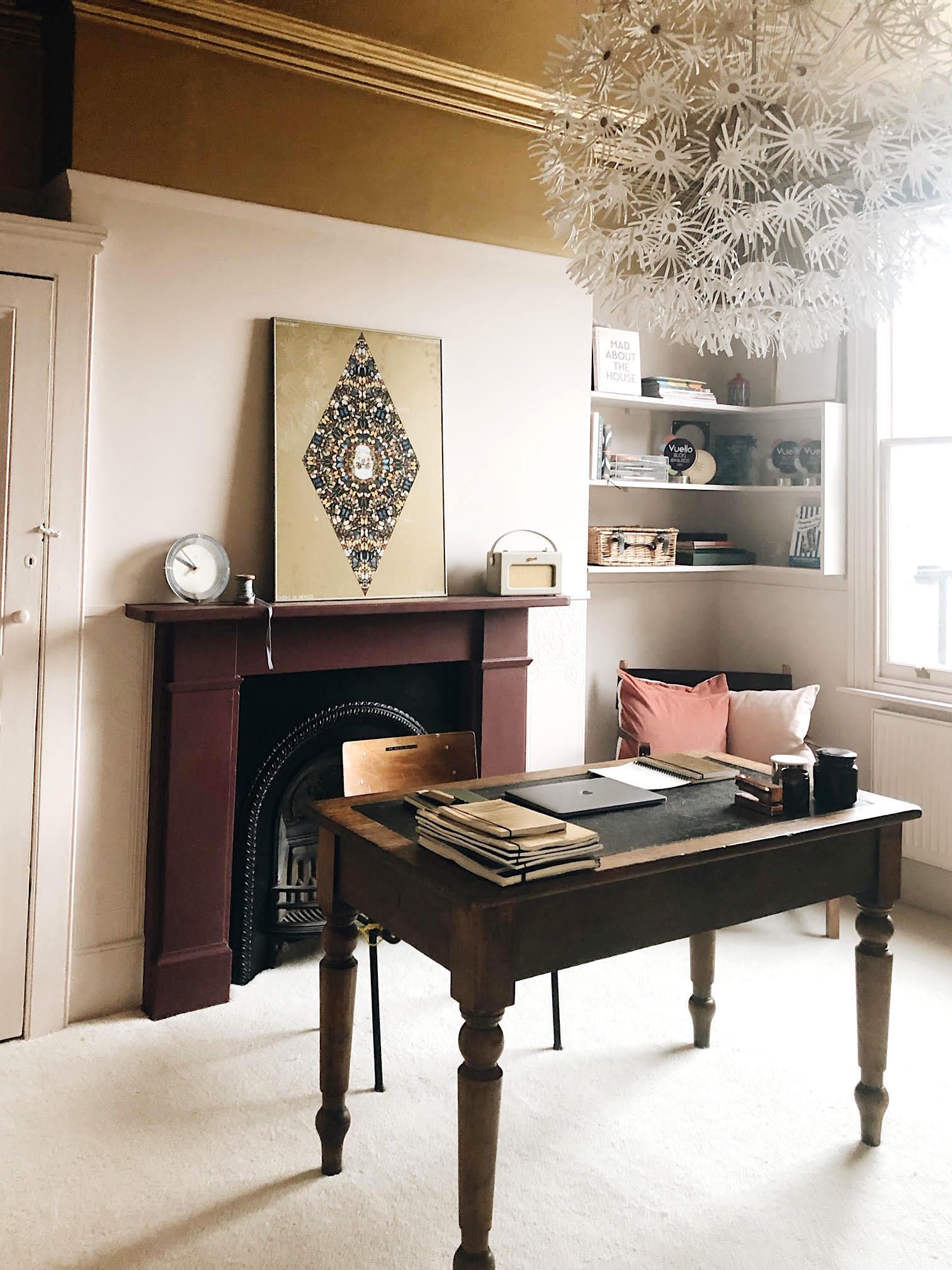 Home office with gold ceiling and pale pink walls blelongs to interior design auther Kate Watson Smyth and shows how you can work from home at a desk from ebay all discussed in the interior design podcast The Great indoors co hosted with Sophie Robinson