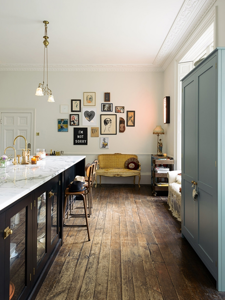 The insta famous DeVol kitchen complete with vintage furniture, modern artworks, marble worktops and fringed lampshades