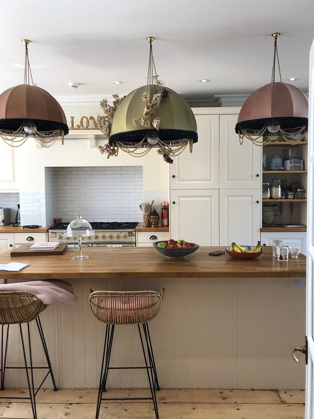 The home of TV presenetr Fearne Cotton kitchen island with three oversized pendant lights