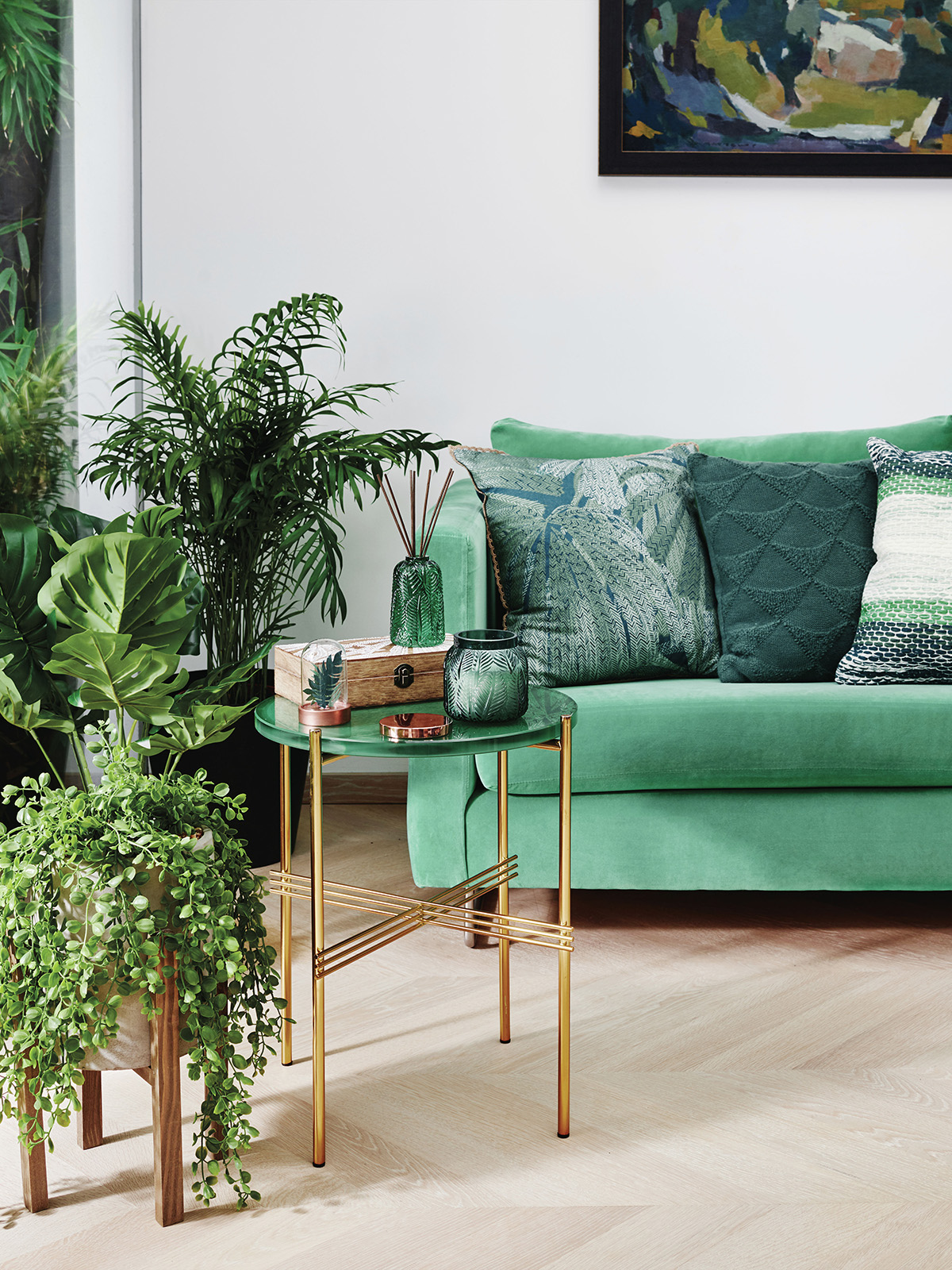 Biophilia and the benefits of introducing plants and greenery to the home are discussed by interior designer Sophie Robinson. A green velevet sofa, plenty of houseplants and light interiors all create the look. read more here. #biophilia #sophierobinson #podcast #thegreatindoors