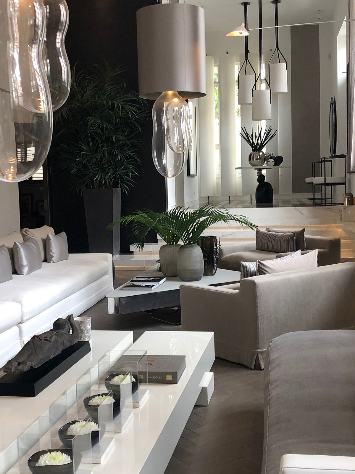 Home of interior designer Kelly Hoppen with open plan living space and entrance in her signature taupe. For the full house tour listen to the Great Indoors podcast with Sophie Robinson and Kate Watson Smyth. #openplan #sophierobinson #kellyhoppen