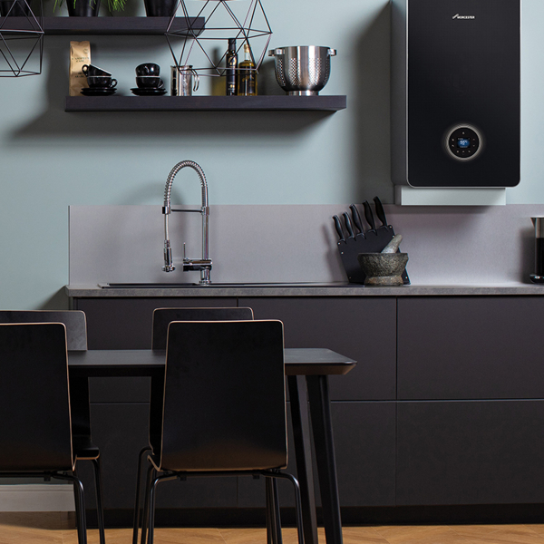 Interior designer Sophie Robinson looks at the new designer look boiler by Worcester Bosch. The black design fits seamlessly with this modern black kitchen. #blackkitchen #kitchen #boiler