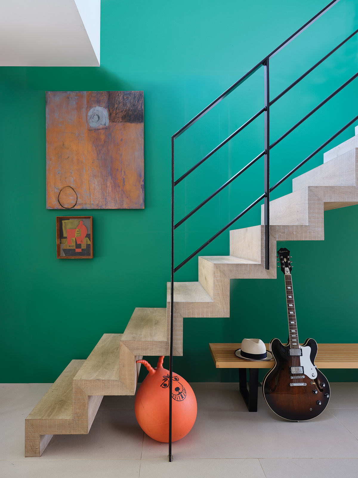 Interior Designer Sophie Robinson takes a look at the new paint collection by Farrow & Ball and the Natural History Museum. The Verdigris Green is used in the entrance hall with a modern black metal bannister yet creates a welcoming space. #sophierobinson #farrowandball #entrancehall