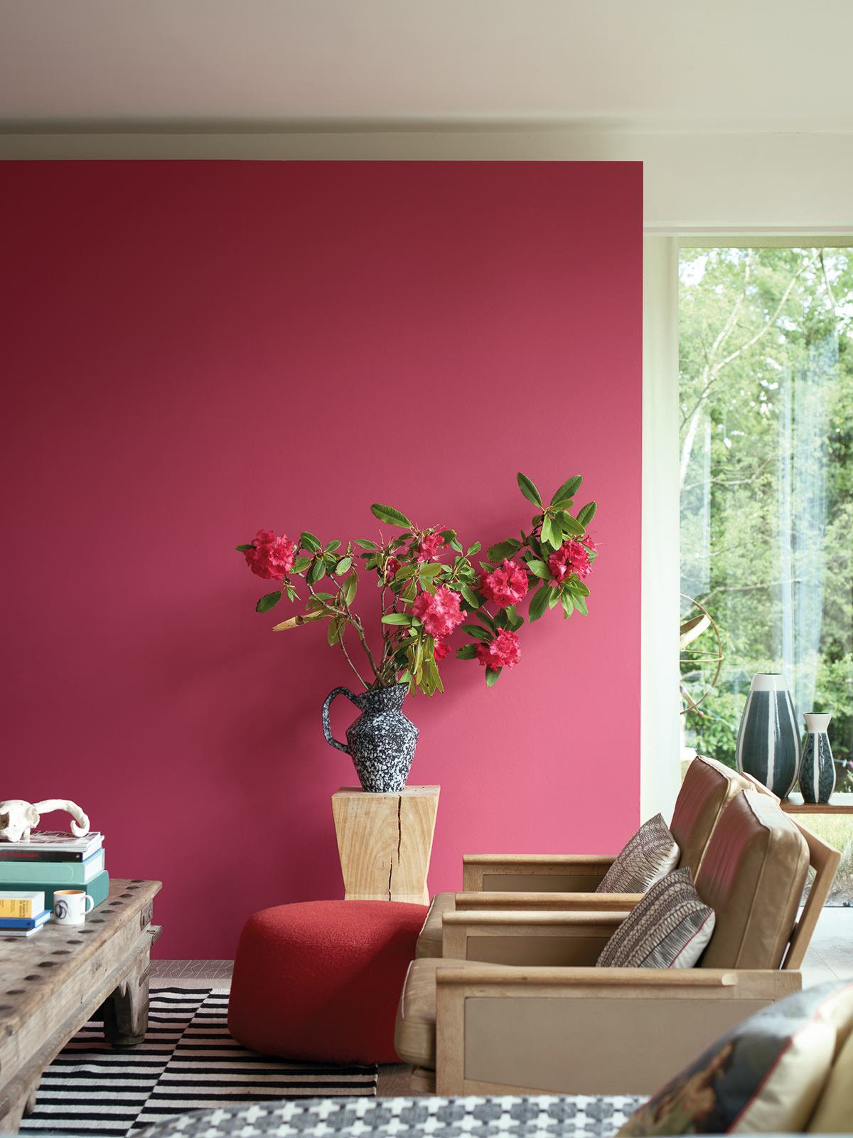 Farrow & Ball launch a new paint collection in conjunction with the Natural History Museum. The Lake Red colour is a classic tone and is brought up-to-date with modern wooden living room furniture and a focal floral display. Sophie Robinson looks at overall collection, find out more here #farrowandball #sophierobinson #livingroom