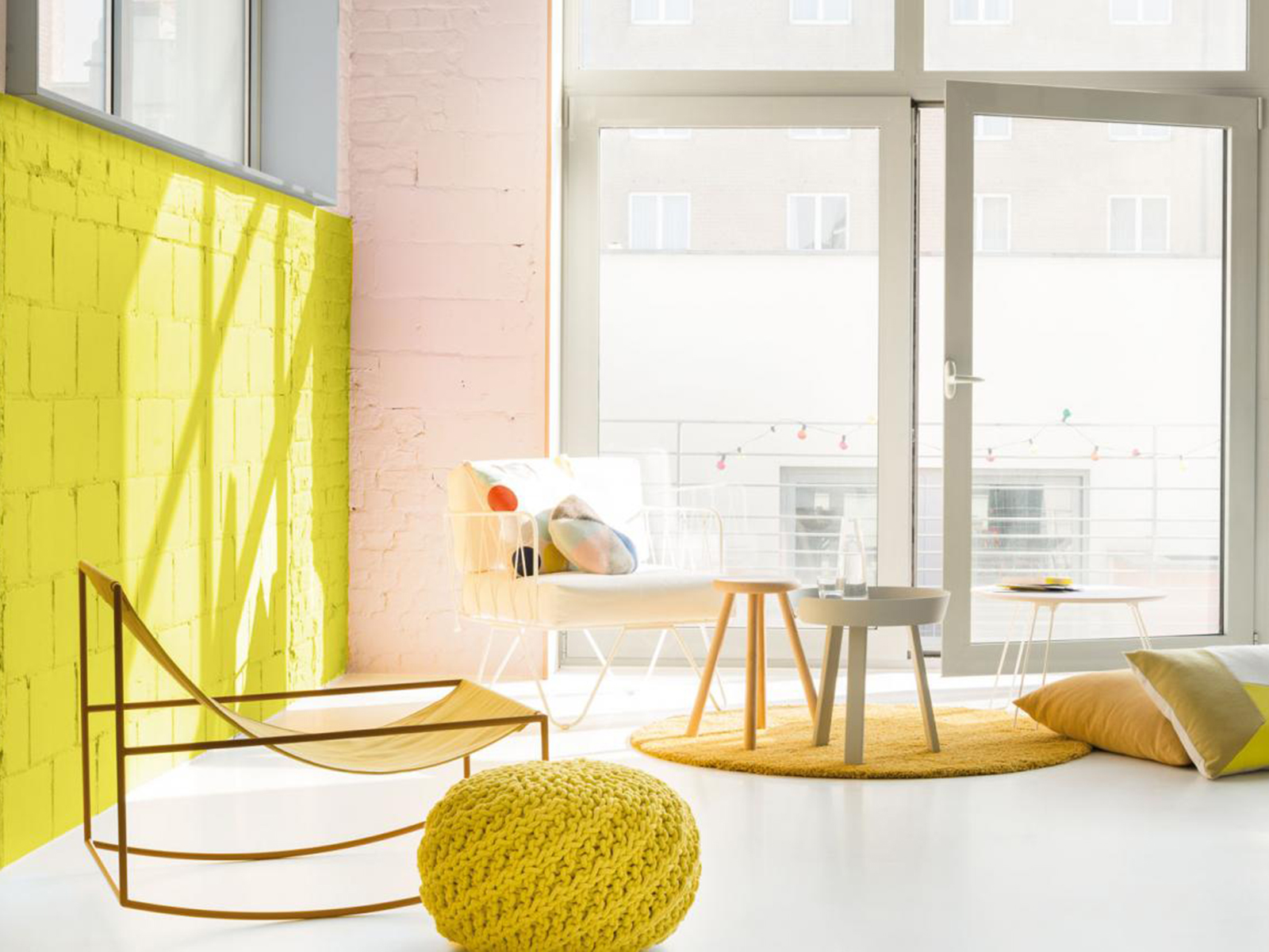 Colour lover Sophie Robinson shares her latest colour crush, pink and yellow. The industrial feel of the scheme is softened with one yellow wall and one pink and the contemporary furniture creates a modern look. #colourcrush #warehouse #sophierobinson