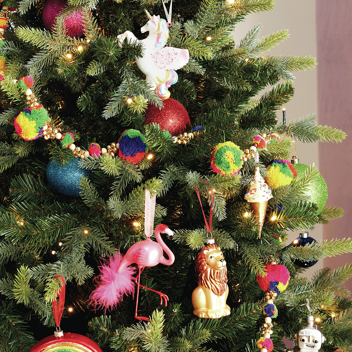 Sophie Robinson tells us why she favours real over faux. Brightly coloured tree decorations really pop out of the natural green pine. #Christmastrees #sophierobinson