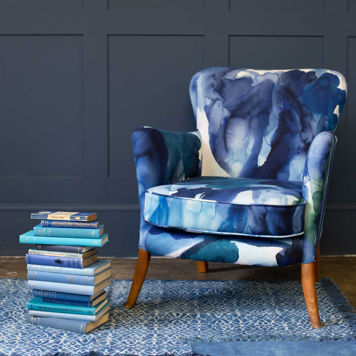 Interior designer and colour lover Sophie Robinson looks at why so many of us are opting for navy within our interiors. The inky watercolour design on this armchair helps to add interest and pattern to a room scheme. #navydecor #colourcrush #sophierobinson