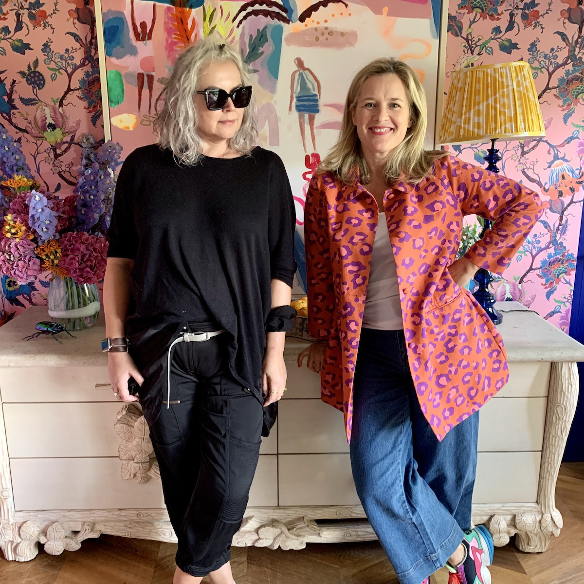 Kate Watson-Smyth and Sophie Robinson in Sophie's home office with bold pink floral wallpaper and large vintage sideboard.
