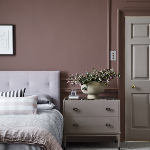 Bedroom with dusky pink wall, plain headboard, stone colour wall and chest of drawers, by Little Greene. Sophie Robinson